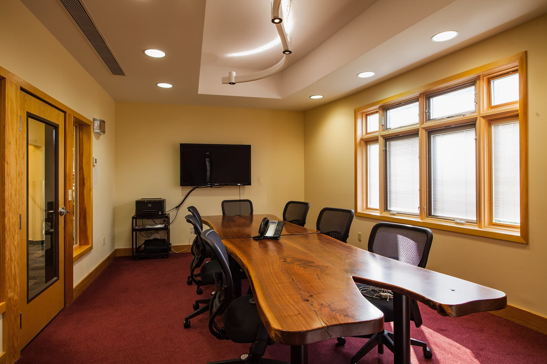 POA meeting room with natural wood table.