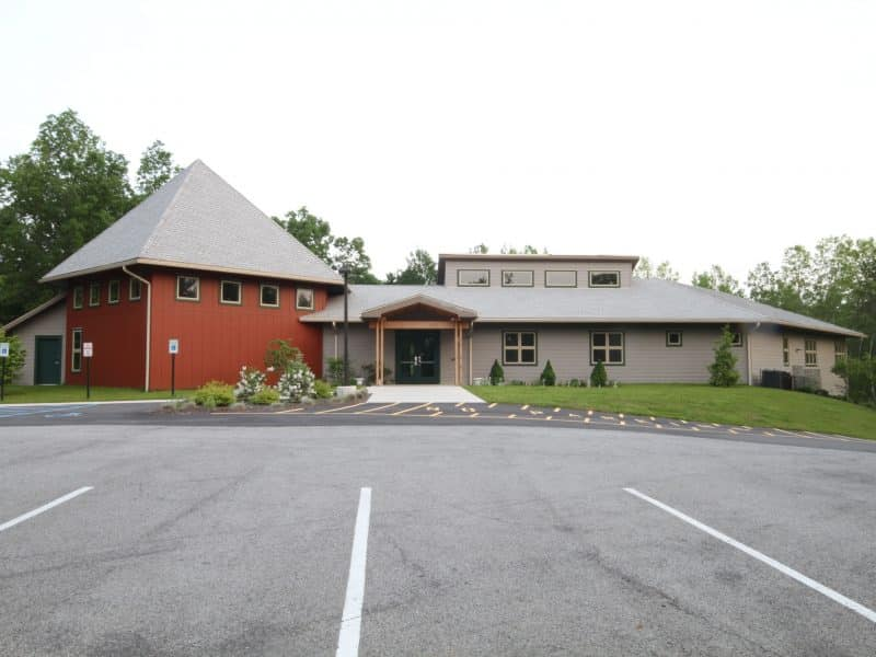 Universalist Unitarian Church - Exterior view of entrance from parking lot.