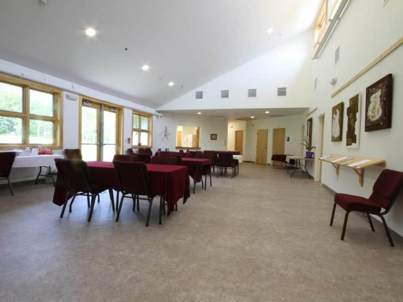 Fellowship hall facing towards religious education rooms and kitchen.