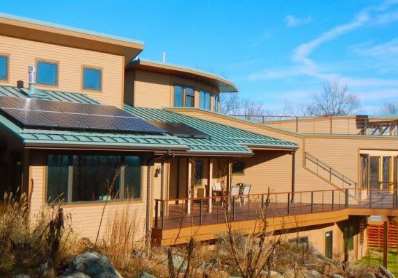 "Image of Energy Star Certified, ""green"" home with solar panels."