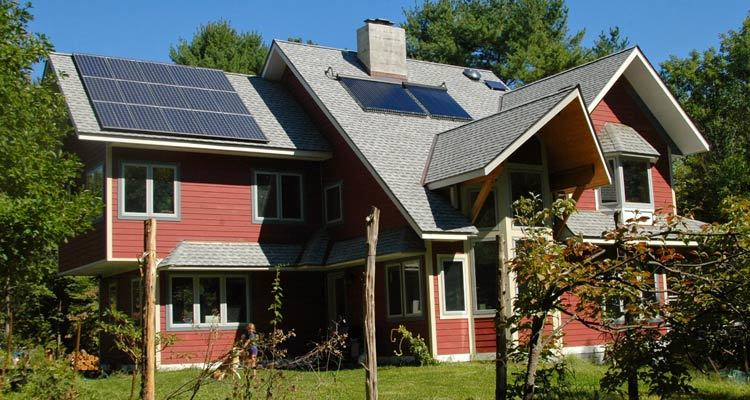 Image of modern home with solar panels.