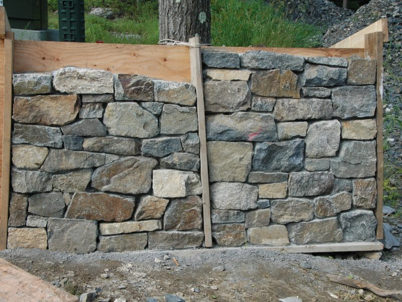 Stone wall samples made by stoneworker before selection.
